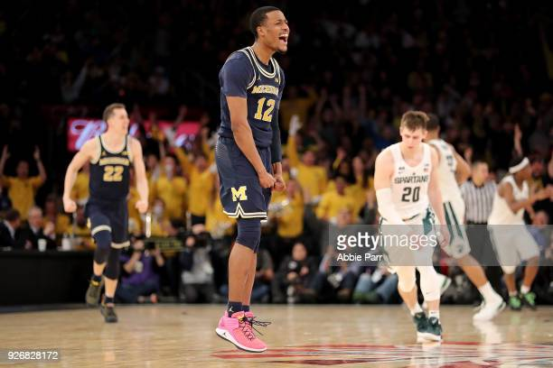 MuhammadAli AbdurRahkman of the Michigan Wolverines reacts in the second half against the Michigan State Spartans during semifinals of the Big 10...
