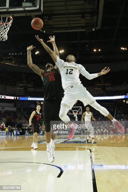 MuhammadAli AbdurRahkman of the Michigan Wolverines shoots against Devin Davis of the Houston Cougars in the second half during the second round of...