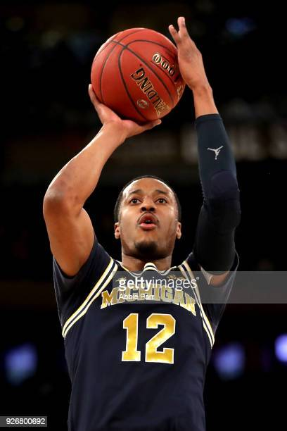 MuhammadAli AbdurRahkman of the Michigan Wolverines takes a shot in the first half against the Michigan State Spartans during semifinals of the Big...