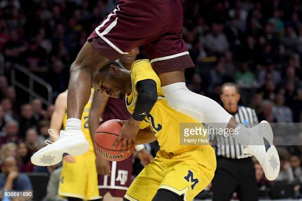 MuhammadAli AbdurRahkman of the Michigan Wolverines with the ball against Robert Williams of the Texas AM Aggies in the first half in the 2018 NCAA...