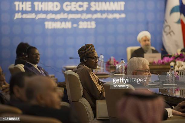Muhammadu Buhari Nigeria's president center listens at a meeting with representatives of state during the Gas Exporting Countries Forum summit in...