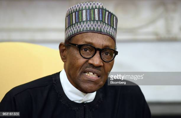 Muhammadu Buhari Nigeria's president speaks during a meeting with US President Donald Trump not pictured in the Oval Office of the White House in...
