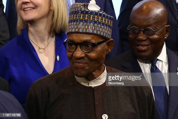 Muhammadu Buhari, Nigeria's president, takes part in a family photo with leaders of African countries at the U.K. - Africa Investment Summit at the...