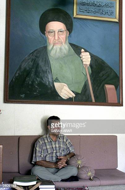 Muhammed Abdul Karim alMadani sitting under a painting of his father Abdel karim alMadani gives an interview to AFP at his house in Baquba 66 kms...
