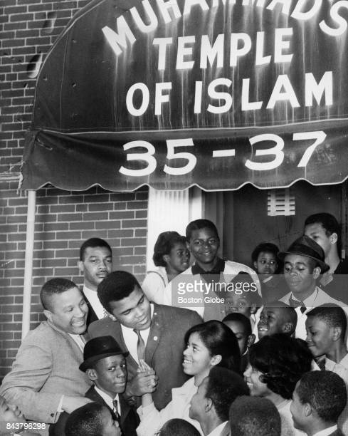 Muhammed Ali outside Muhammad's Temple of Islam mosque on Intervale Street in the Roxbury neigborhood of Boston on April 19 1964