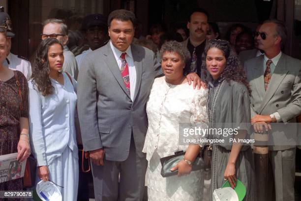 Muhammed Ali outside St Bartholomew's Hospital London after visiting fellow boxer Michael Watson with his twin daughters Rasheeda and Jamillah and...