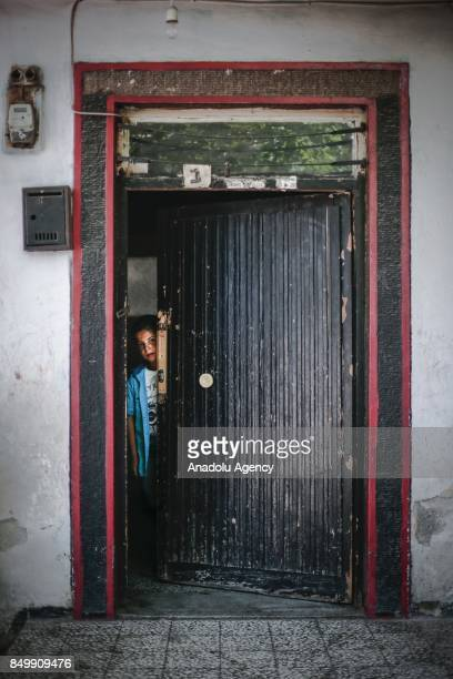 Muhammed Hazze looks behind of a half way open door in Altindag district of Ankara Turkey on July 26 2017 Muhammed fled the ongoing civil war in...