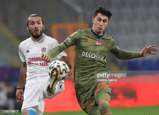 Muhammed Sarikaya of Medipol Basaksehir in action against Mert Ozyildirim of Turgutluspor during Turkish Ziraat Cup 5th round soccer match between...