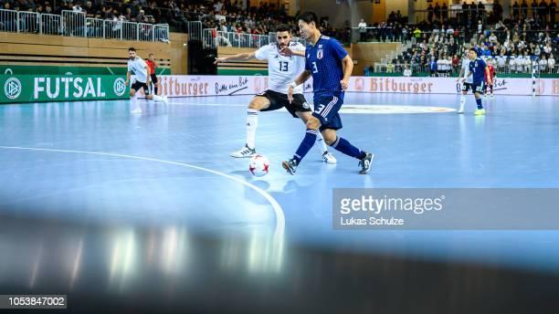 Muhammet Soezer of Germany battles for possession with Shunta Uchimura of Japan  during the futsal international 43d488a603d87