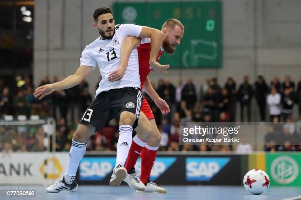 Muhammet Soezer of Germany challenges Elia Waelty of Switzerland during the  Futsal match between Germany and d794d75701711