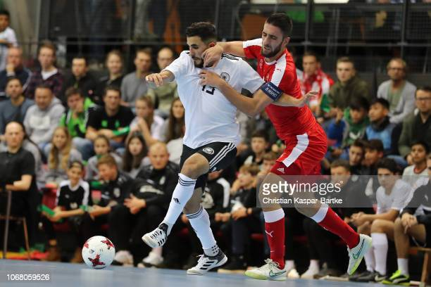 Muhammet Soezer of Germany challenges Evangelos Marcoyannakis of  Switzerland during the Futsal match between Germany and 87cefcf3f42aa