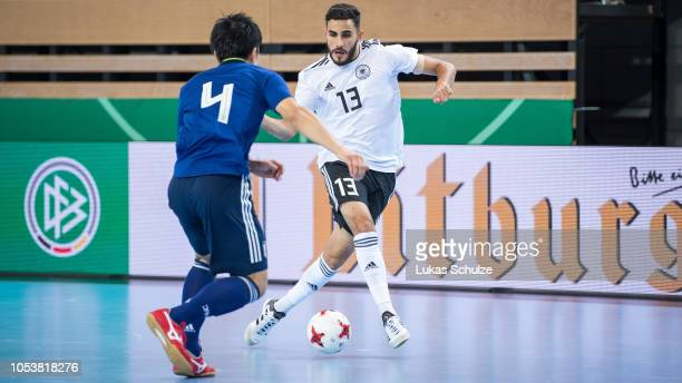 Muhammet Soezer of Germany challenges for the ball with Ryohei Ando of Japan  during the futsal 86a77a1cc98e0