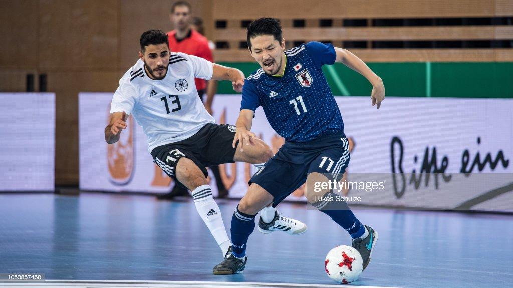 Muhammet Soezer of Germany challenges for the ball with Shota Hoshi ... 4997d915a1775
