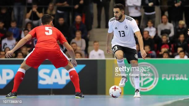 Muhammet Soezer of Germany challenges Luiz Felipe Farias of Switzerland  during the Futsal match between Germany b68d845b65c11