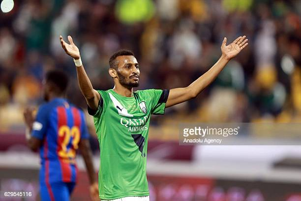 Muhannad Assiri of Al-Ahli Saudi celebrates his goal during a friendly soccer match between Al-Ahli Saudi and Barcelona at Al-Gharrafa Stadium in...