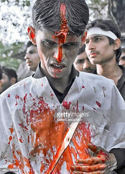CONTENT] Muharram Mumbai Shitte Muslim cutting himself as part of a commemorative ritual during Muharram Mumbai India