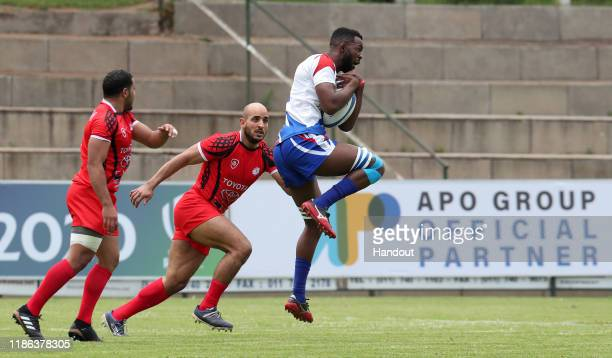 Muharua Katjyeko of Namibia challenged by Bilal Soken of Tunisia during the 2019 Rugby Africa Mens 7s match between Tunisia and Namibia at the Bosman...