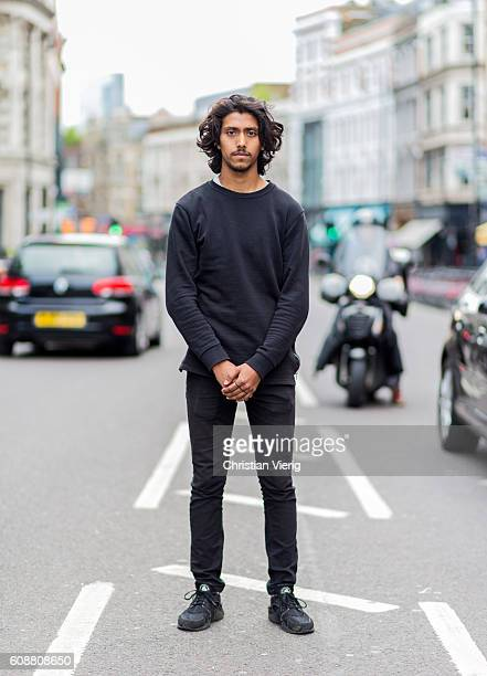 Muhi Miah wearing a black sweater outside during London Fashion Week Spring/Summer collections 2017 on September 19 2016 in London United Kingdom