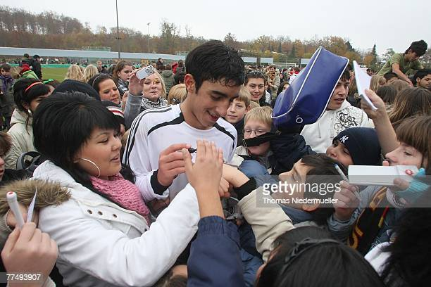 Muhittin Bastuerk of Germany signs autographs after the Men's U17 Euro qualifier match between Germany and the Faroe Islands in the 'Albstadion' on...