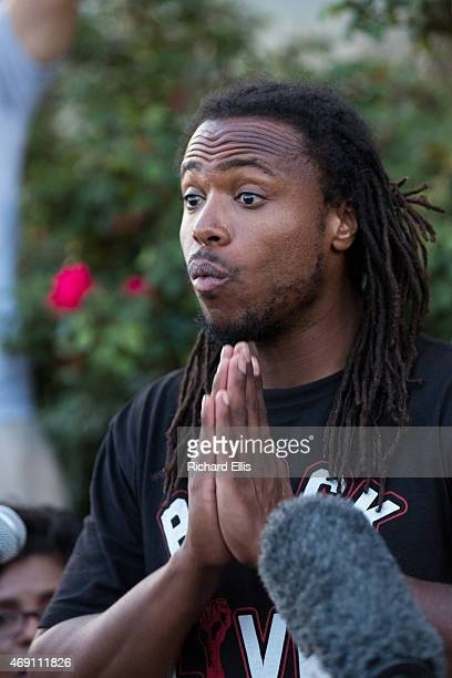 Muhiydin Moye D'Baha of the Black Lives Matter movement speaks to the press following a North Charleston City Council on April 9 2015 in North...