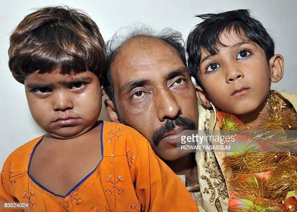 Muhmad Islamil father of underage groom hold his ten year old son Muhmad Wasim and his three year old bride Nisha Nasir in police custody in Karachi...
