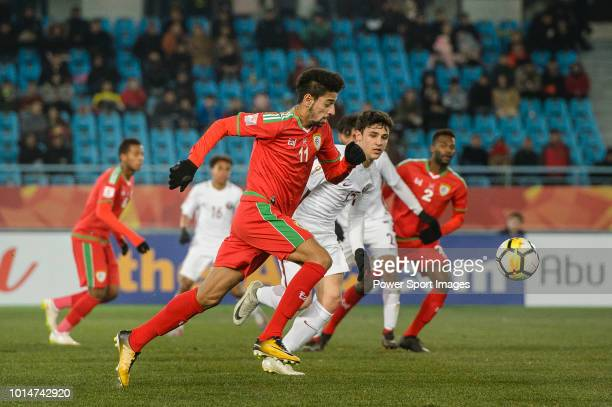 Muhsen Al Ghassani of Oman in action against Bassam Al Rawi of Qatar during the AFC U23 Championship China 2018 Group A match between Oman and Qatar...