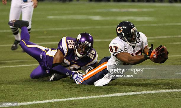 Muhsin Muhammad of the Chicago Bears comes up short of a touchdown as Antoine Winfield of the Minnesota Vikings hauls him down at the Hubert H...