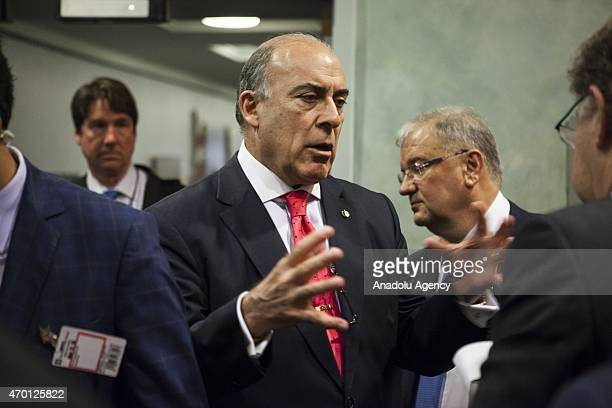 Muhtar Kent CEO of CocaCola Company speaks with guests after a B20 panel during the 2015 IMF/World Bank Spring Meetings in Washington USA on April 17...