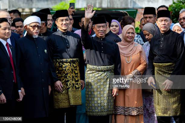 Muhyiddin Yassin Malaysia's newly appointed Prime Minister waves to the media outside his house with his family and supporters before departing for...