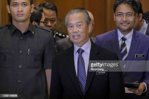 Muhyiddin Yassin Malaysia's prime minister center arrives for a news conference in Putrajaya Malaysia on Monday March 9 2020 Malaysias prime minister...