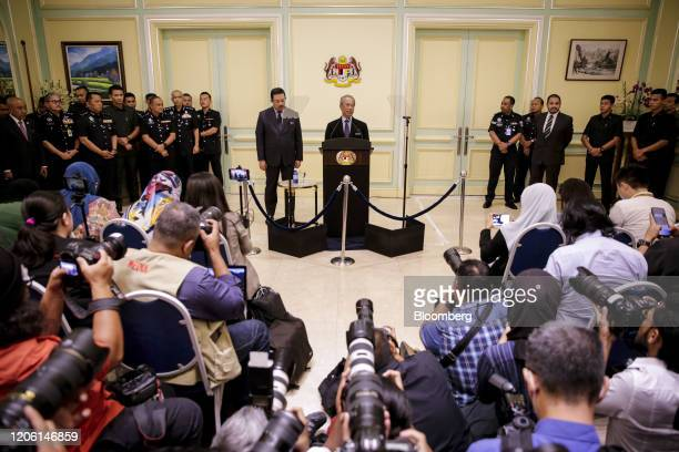 Muhyiddin Yassin Malaysia's prime minister center speaks during a news conference in Putrajaya Malaysia on Monday March 9 2020 Malaysias prime...