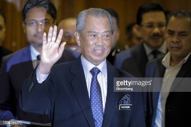 Muhyiddin Yassin Malaysia's prime minister gestures as he arrives for a news conference in Putrajaya Malaysia on Monday March 9 2020 Malaysia's prime...