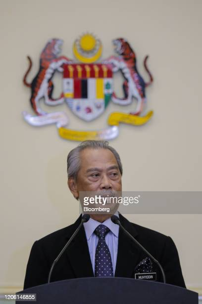 Muhyiddin Yassin Malaysia's prime minister pauses during a news conference in Putrajaya Malaysia on Monday March 9 2020 Malaysias prime minister...