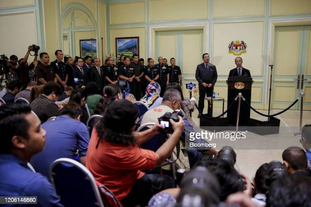 Muhyiddin Yassin Malaysia's prime minister speaks from a podium during a news conference in Putrajaya Malaysia on Monday March 9 2020 Malaysias prime...