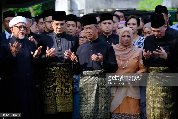 Muhyiddin Yassin Malaysia's prime ministerdesignate center prays with his members of parliament at his home before leaving for a swearing in ceremony...