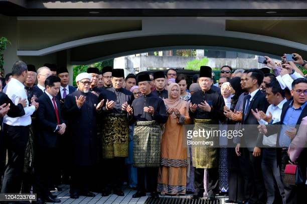 Muhyiddin Yassin Malaysia's prime ministerdesignate center prays with members of parliament at his home before leaving for a swearing in ceremony at...