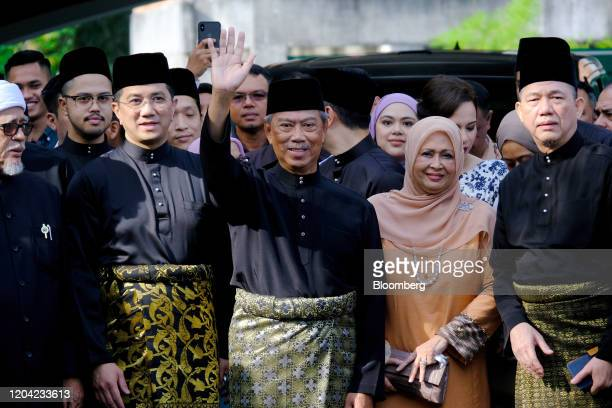 Muhyiddin Yassin Malaysia's prime ministerdesignate center waves to members of the media at his home before leaving for a swearing in ceremony at the...