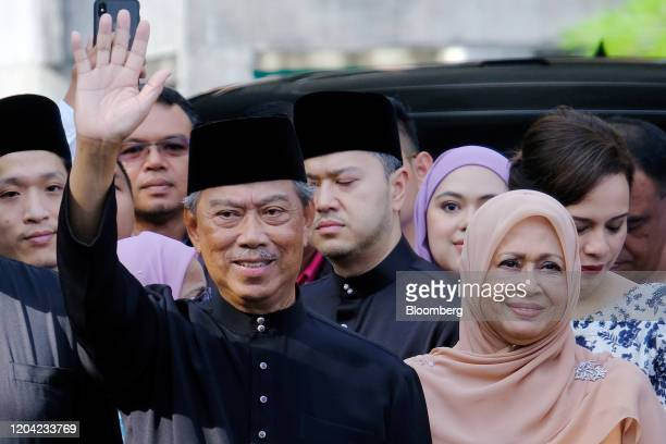 Muhyiddin Yassin Malaysia's prime ministerdesignate left waves to members of the media at his home before leaving for a swearing in ceremony at the...