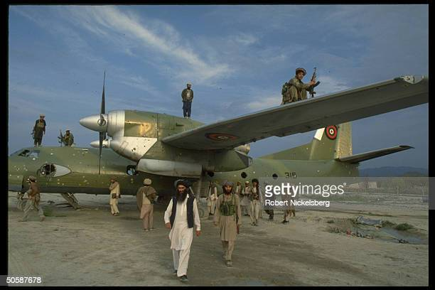 Mujahedeen w Antonov32 Sovietmade cargo plane at mil airport in garrison city rebels seized fr Kabul troops in 16day battle