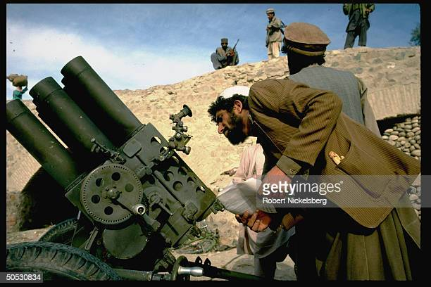 Mujahideen during rebel assault on Jalalabad loading shells into Chinese BM12 rocket laucher