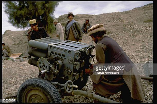 Mujahideen during rebel assault on Jalalabad loading shells into Chinese BM12 rocket launcher