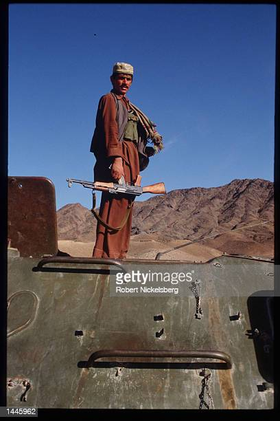 A mujahideen stands on a captured Soviet T55 tank March 15 1989 in Jalalabad Afghanistan The end of Soviet military occupation which began in 1979...
