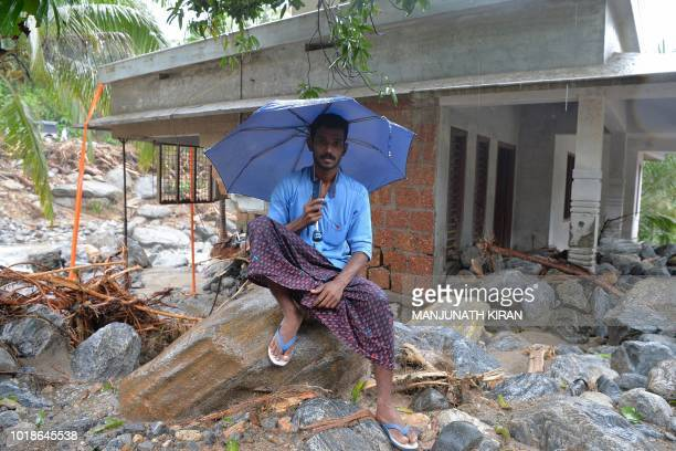 Mujeeb 31 a tipper truck driver sits in front of his newly constructed house which was destroyed by a landslide at Mattikunnu village in Kozhikode...