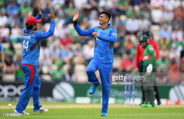 Mujeeb Ur Rahman of Afghanistan celebrates the wicket of Soumya Sarkar of Bangladesh with Asghar Afghan of Afghanistan during the Group Stage match...