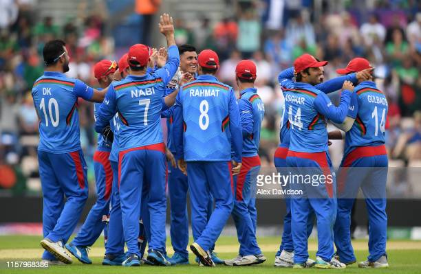 Mujeeb Ur Rahman of Afghanistan celebrates the wicket of Soumya Sarkar of Bangladesh with his teammates during the Group Stage match of the ICC...