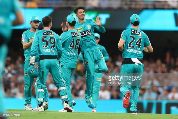 Mujeeb Ur Rahman of the Heat celebrates after dismissing Alex Hales of the Thunder during the Big Bash League match between the Brisbane Heat and the...
