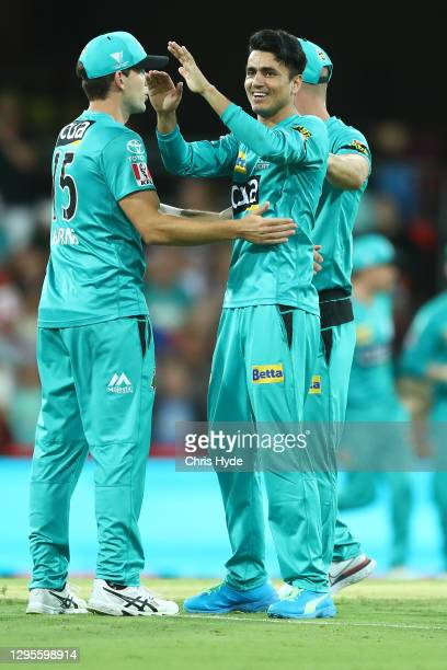 Mujeeb Ur Rahman of the Heat celebrates after dismissing James Vince of the Sixers during the Big Bash League match between the Sydney Sixers and the...