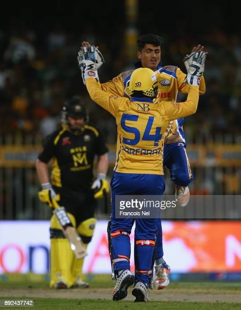 Mujeeb Zadran and Sarfraz Ahmed of Bengal Tigers celebrates the wicket of Eoin Morgan of Kerela Kingsduring the T10 League match between Bengal...