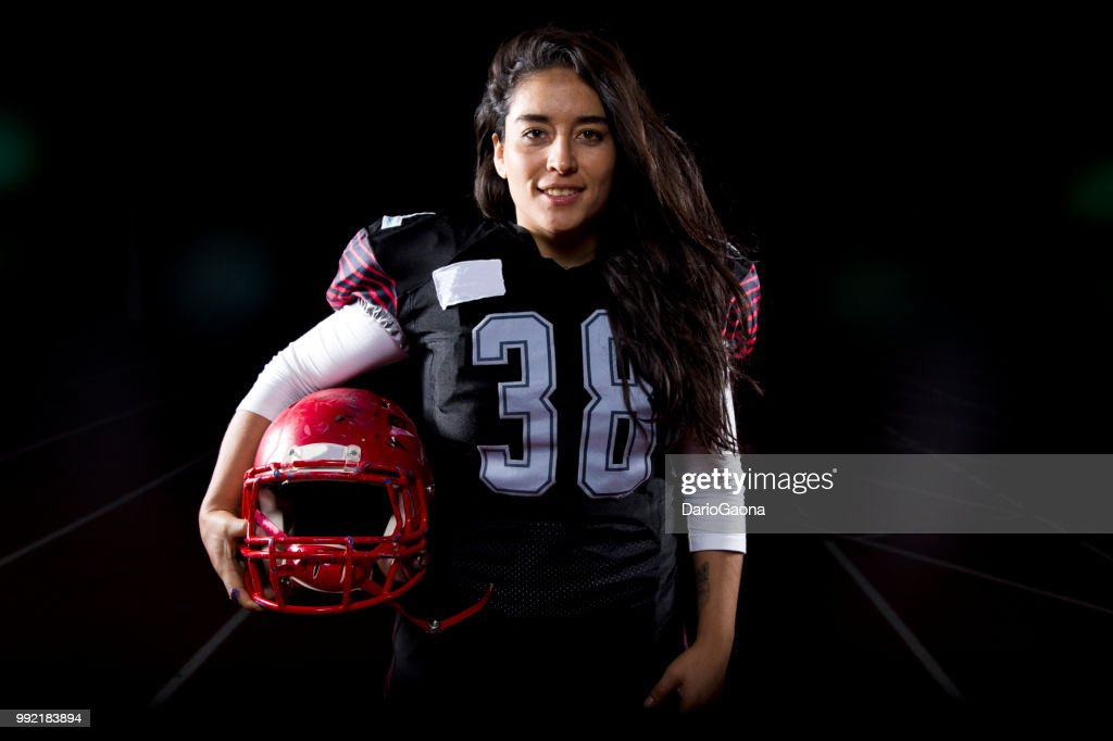 Mujer football americano : Stock Photo