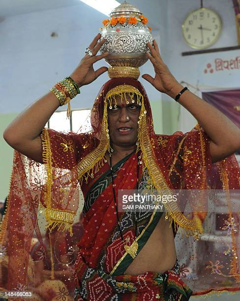 Mujra Nani Bakas an Indian member of the eunuch community performs a World Peace Yagna ritual in Ahmedabad on July 17 2012 The program was sponsored...